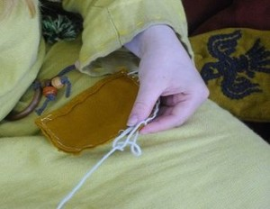 Sewing the purse close up